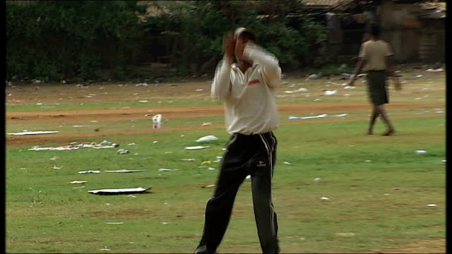General views and cricket practice in Mumbai Practice taking place on field with players hitting and catching ball
