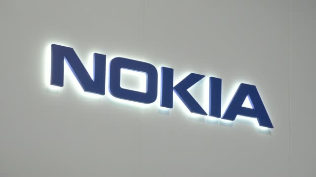 general views attendees pass the nokia oyj pavilion on day three of the mobile world congress in barcelona spain on wednesday feb 26 nokia sign an... - タッチスクリーン点の映像素材/bロール