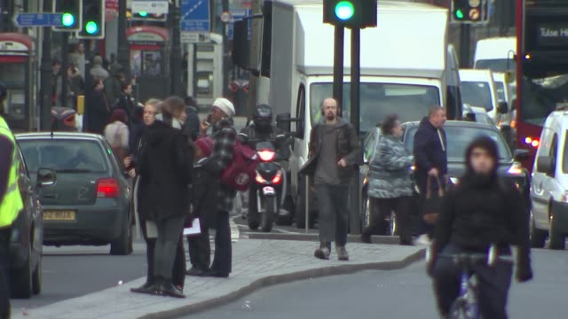 general views brixton traffic; england: london: brixton: ext gvs traffic and buses along under railway bridge, pedestrians crossing road / soft focus... - soft focus stock videos & royalty-free footage
