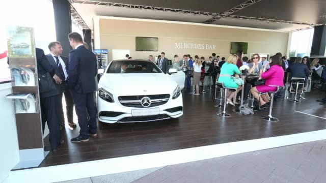 vídeos y material grabado en eventos de stock de general views businessmen and women sit on the terrace of the mercedes bar sponsored by mercedes benz ag at the st petersburg international economic... - insignia accesorio personal