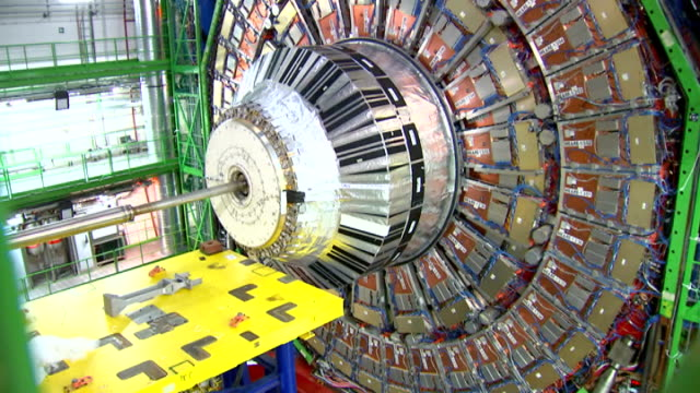 General views CERN Hadron Collider / Interviews Various of equipment section of Large Hadron Colllider and worker examining it