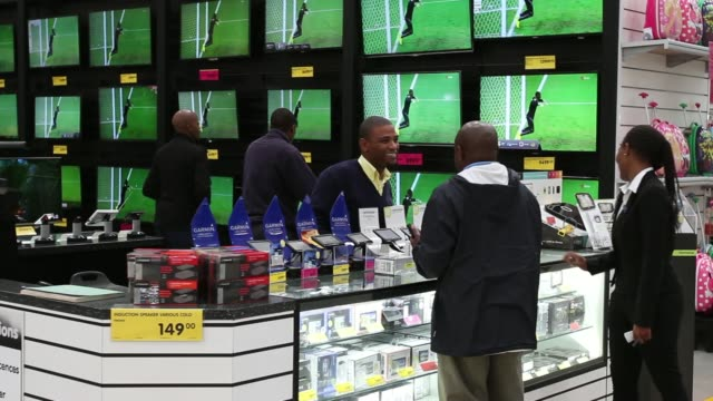 vídeos de stock, filmes e b-roll de general views customers browse flatscreen televisions and other electronic goods on display inside a makro cash and carry store operated by massmart... - produto interno bruto