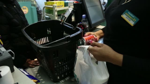 General views customers inside a Poundland discount store operated by Poundland Group Plc in London UK on Friday March 7 GVs an employee places...