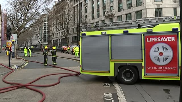 General views fire under Holborn's Kingsway ENGLAND London Holborn EXT Fiirefighters BT Openreach workers and safety inspectors at scene behind...