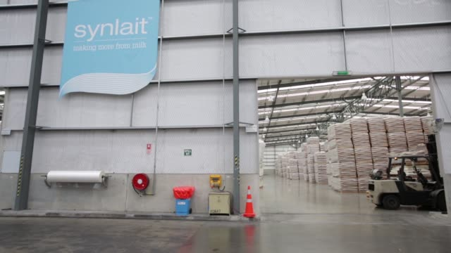 general views forklift operators drive through a warehouse at the synlait milk ltd manufacturing plant in the town of rakaia 60km from christchurch... - カンタベリー点の映像素材/bロール