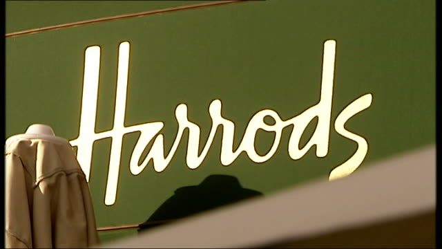 general views harrods 'harrods' name plate on marble wall / harrods sign outside entrance / cars parked outside store / detail on harrods exterior /... - marble wall stock videos and b-roll footage