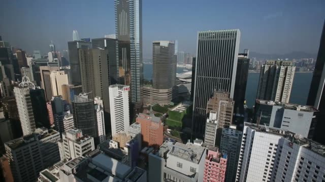 stockvideo's en b-roll-footage met general views high rise buildings stand in the wan chai district of hong kong china on thursday dec5 the cheung kong center stands in the central... - hongkong eiland