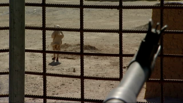 general views looking out from an army base lookout post at lashkar gah; afghanistan: helmand province: lashkar gah: ext various views through wire... - international security assistance force stock videos & royalty-free footage