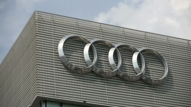 general views new vehicles for sale sit parked on display outside an audi ag automobile showroom in moscow russia on saturday aug 2 the four rings of... - autohandlung stock-videos und b-roll-filmmaterial