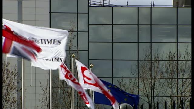general views news international print works at wapping england london wapping ext general views flags flying outside news international printing... - ニュースオブザワールド紙点の映像素材/bロール