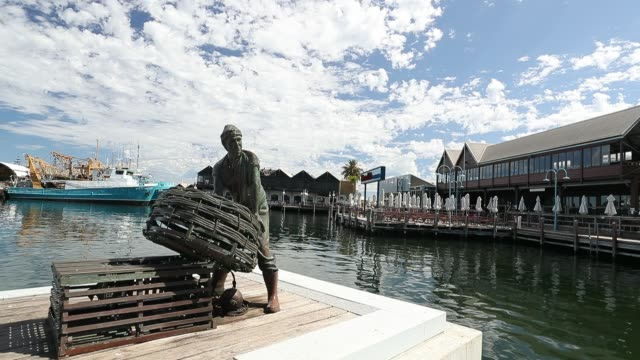 general views of a deserted cicerello's landing fishing boat harbour are seen on march 26, 2020 in fremantle, australia. further restrictions on... - フリーマントル点の映像素材/bロール