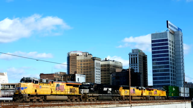 general views of a freight train moving through the city of birmingham, alabama november. embattled gop senate candidate in alabama judge roy moore... - 貨物列車点の映像素材/bロール