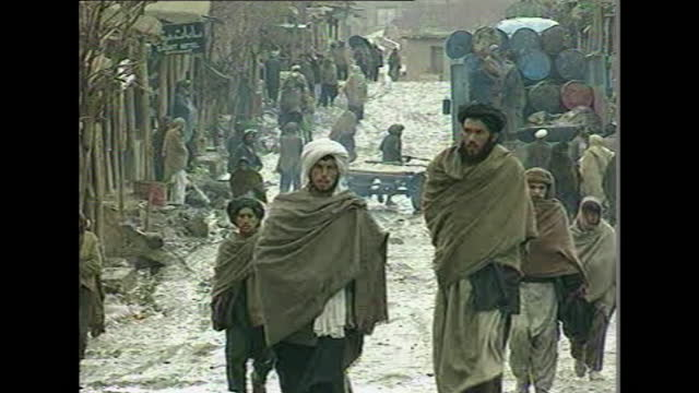 """general views of a taliban controlled village in the shibar pass, afghanistan; 1997. - """"bbc news"""" stock videos & royalty-free footage"""