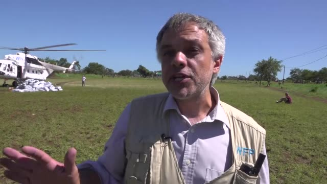 general views of aid being loaded onto plane and being flown to victims of cyclone idai shows interview with unknown at airfield people watching aid... - cyclone stock videos and b-roll footage
