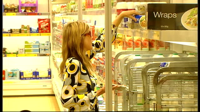 general views of aldi supermarket aldi shoppers in health and beauty section / woman browsing items on shelf / woman looking at chilled food / aldi... - cards stock videos & royalty-free footage
