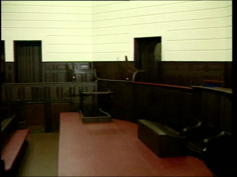 general views of an empty court room in the royal courts of justice england london royal courts of justice ext close view of sign and coatorarms on... - court room stock-videos und b-roll-filmmaterial