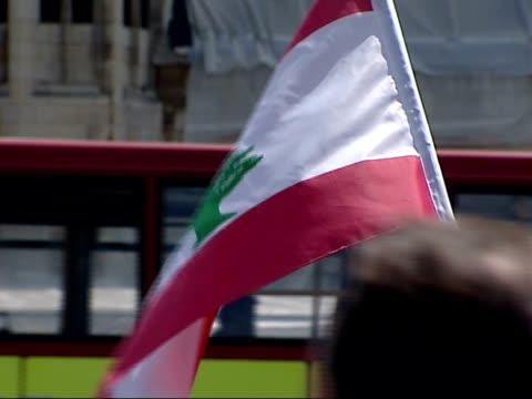 general views of antiwar demonstration by lebanese protestors against israel and the us england london ext crowd of people gathered for protest pan /... - lebanese flag stock videos and b-roll footage