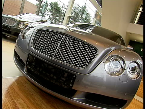 stockvideo's en b-roll-footage met general views of barvikha luxury village near moscow; int various of bentley and lamborghini cars in car showroom, includes close ups of car... - toonzaal