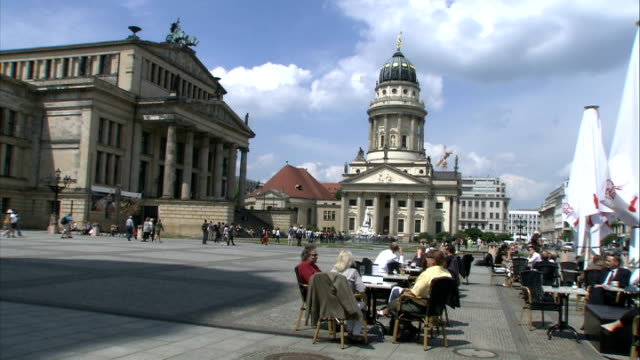 Reichstag building Siegessaeule Brandenburg Gate Hauptbahnhof night life Good general views of Gendarmenmarkt public square with people at tables of...