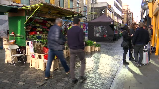 general views of berwick street market in soho england london soho berwick street ext market trader working on fruit and veg stall / close shots of... - chef stock videos & royalty-free footage