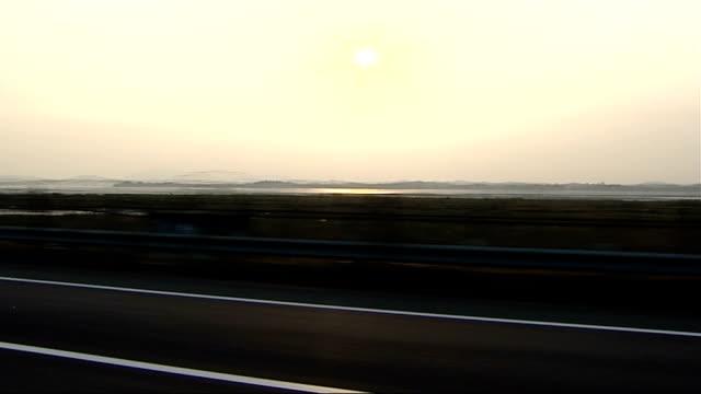 general views of border area evening / sunset tracking shot along border next river - gesamtansicht stock-videos und b-roll-filmmaterial