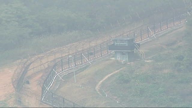 general views of border area north watchtower topped with two security cctv cameras / air views barbed wire fence along border / air view watchtower... - barbed wire stock videos & royalty-free footage