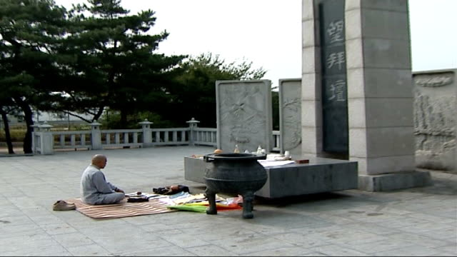 general views of border area; south korea: near demilitarized zone dmz: family altar: buddhist monk praying at shrine sitting cross-legged before... - shrine stock videos & royalty-free footage