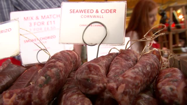 general views of borough market; england: london: borough market: int 'cannon & cannon' british charcuterie stall / close shots of cured meats and... - chorizo stock videos & royalty-free footage