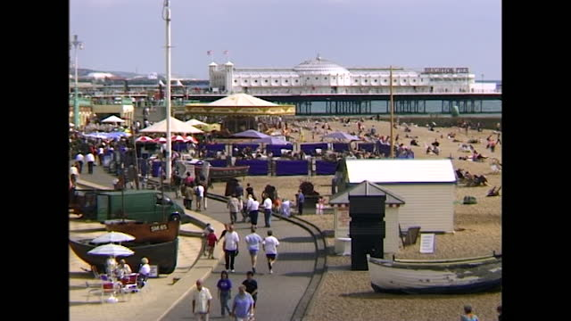 general views of brighton's seaside including deck chairs on a beach, people sunbathing as seagulls fly overhead near brighton palace pier and wide,... - pattern stock videos & royalty-free footage