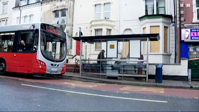 general views of bristol; general views of stapleton road area including bus stop, traffic along, seats in bus stop, bus stopping at bus stop, legs... - stapleton stock videos & royalty-free footage