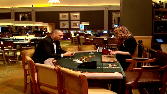 general views of casino; england: london: int good shots general view of interior of casino / gambler counting out packs of cards / various of... - croupier stock videos & royalty-free footage
