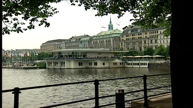 general views of central hamburg germany hamburg ext shuttered window / rooftop pull out to buildings by the inner alster one of two artificial lakes... - dresdner bank stock videos and b-roll footage