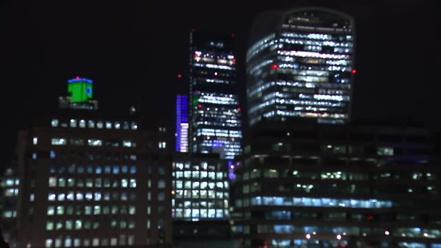 general views of city of london at night england london the city people along bridge with skyscrpers in background / various shots of city buildings... - fensterfront stock-videos und b-roll-filmmaterial