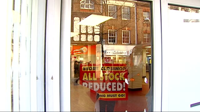 vídeos de stock, filmes e b-roll de general views of closed down woolworths store in croydon employees sticking paper over windows of woolworths store so shop interior is hidden from... - woolworths