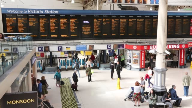 general views of commuters and tourists at victoria station in london uk - railway station platform stock videos & royalty-free footage