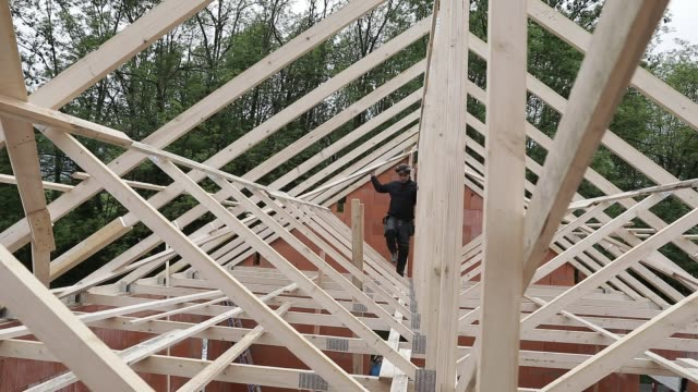 general views of construction workers building a rooft at a house on april 21, 2020 during lockdown in chambery, france. - building activity stock videos & royalty-free footage