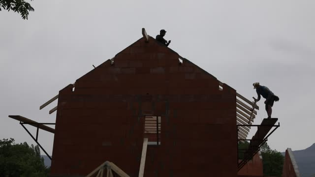 general views of construction workers building a rooft at a house on april 21, 2020 during lockdown in chambery, france. - wood material stock videos & royalty-free footage