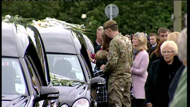 general views of cortege through carterton england oxfordshire carterton general view of funeral procession along / general view of relative placing... - funeral procession stock videos & royalty-free footage