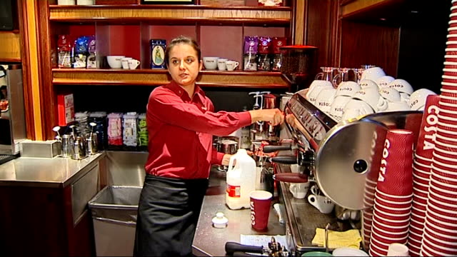 general views of costa and starbucks coffee shops england london int costa coffee barista preparing coffee and explaining method of making a skinny... - mocha stock videos and b-roll footage