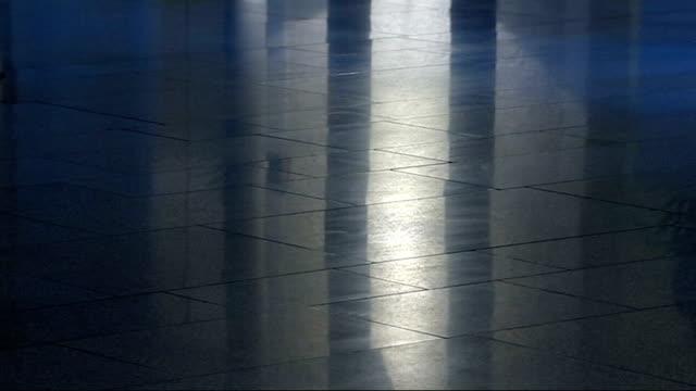 general views of dundee exteriors and interiors of holyrood and night views of central glasgow anonymous shots of feet along corridor - スコットランド ダンディー点の映像素材/bロール