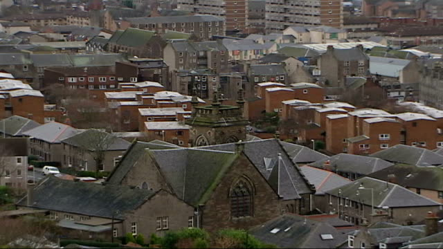 general views of dundee exteriors and interiors of holyrood and night views of central glasgow dundee docks / dundee church and housing / warehouses... - スコットランド ダンディー点の映像素材/bロール