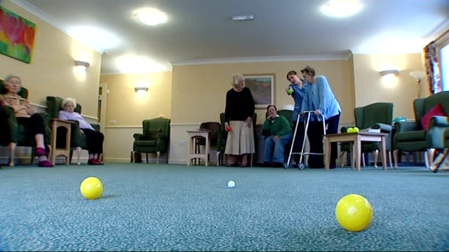 General views of elderly people in residential care home ENGLAND Berkshire Thatcham Court Nursing Home INT General views of elderly people playing...