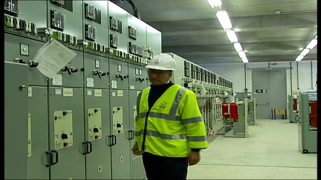 general views of electricity substation int electricity station worker in flourescent jacket with badge reading 'edf energy' inspecting dials in... - fuse box stock videos and b-roll footage
