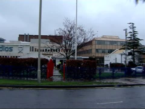 general views of elstree film and television studios; england: hertfordshire: elstree film and television studios: ext / raining general views of... - ボーハムウッド点の映像素材/bロール