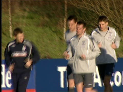 General views of England squad training Various of England team jogging along pitch during training practice PAN / Barton skipping along PAN /...