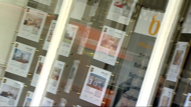 general views of estate agents and properties for sale england london clapham ext bushells estate agents window including advertisements for... - for sale englischer satz stock-videos und b-roll-filmmaterial