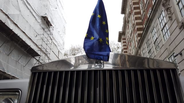 general views of european flag placed on the top of the spirit of ecstasy rolls royce none of the eight proposals put to the vote in the house of... - rolls royce videos stock videos & royalty-free footage