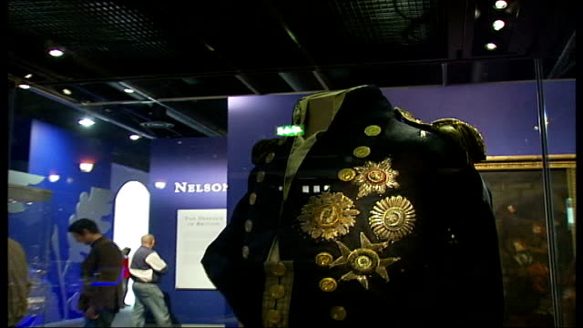 general views of exterior and interior of national maritime museum exhibits in display cabinets inside museum close up of lord nelson's coat showing... - admiral nelson stock videos and b-roll footage