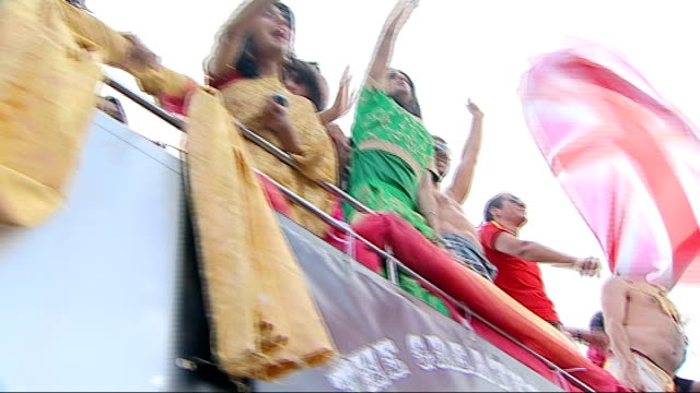general views of gay pride parade in london asian people taking part in gay pride parade / people waving from opentop double decker bus / people... - tomato soup stock videos and b-roll footage