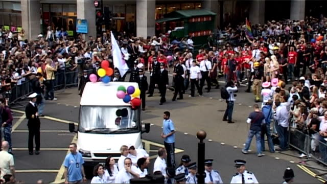 general views of gay pride parade in london high angle view of military personel marching along / high angle view of police officers marching /... - drag queen stock videos and b-roll footage